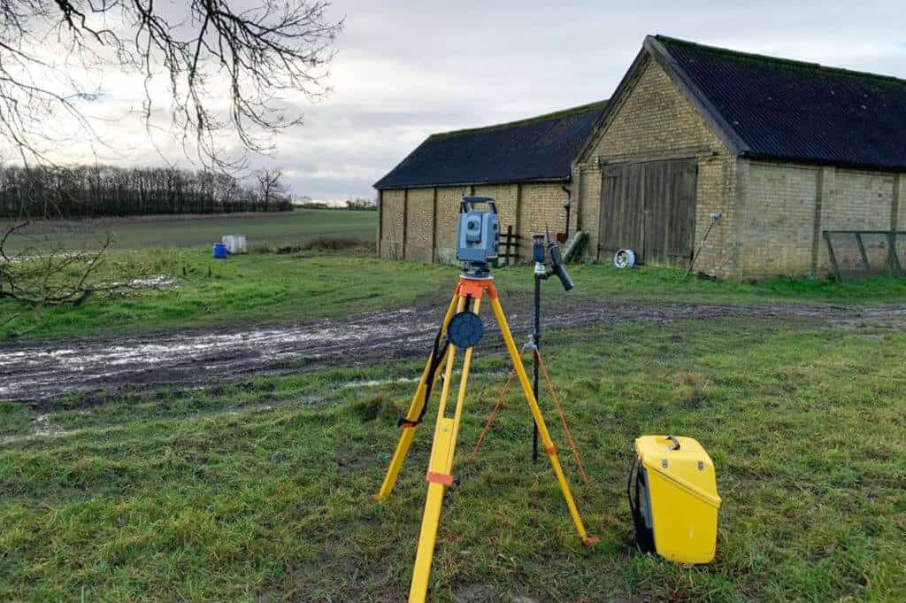Sky revolutions team, with van, setting up a measured building survey